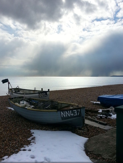 boats and snow at the seaside