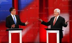 Republican presidential candidate former Massachusetts Governor Mitt Romney and former Speaker of the House Newt Gingrich speak at the Republican presidential candidates debate in Tampa