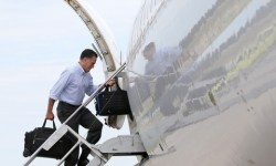 Romney boarding jet