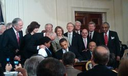 300px-Obama_signing_health_care-20100323