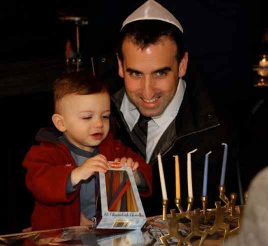 Participants in Chanukah for the Record waited for the go ahead to light their menorahs.