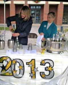 Tamera Matteo and Linda Mather greet visitors and pour sparkling cider to toast the new Princeton.