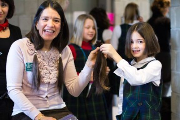 Michelle Dowling, the new Head of Lower School at Stuart was inspired by her daughter Aine, a first grader. They both donated 10 inches of hair to Locks of Love.