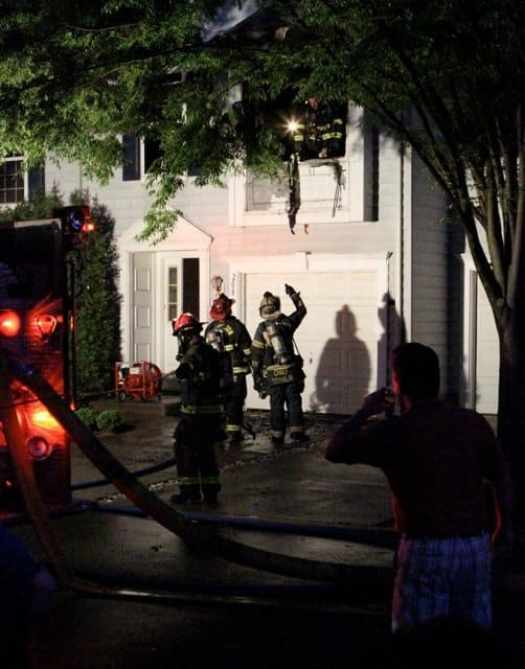 Firefighters put out a fire in the living room of a Griggs Farm condo Thursday night. Photo: Seth Callen.
