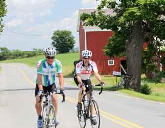 Bob Stults (l) of Dayton, Ohio and Brian McLaughlin of Ewing bike near the Durkey of the e farm in the second day of the Ride for Runaways.