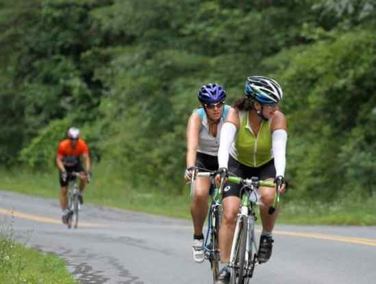 Jaye Plumb (l) rides with her mom, Joan Plumb on the first day of the Anchor House Ride for Runaways.