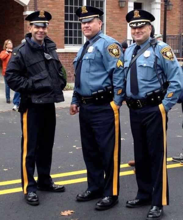 Officers Chris Morgan, Tom Murray and Nick Sutter near the finish line.