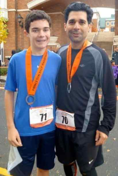 Son Alex and dad Brad Ackerman celebrate after crossing the finish line. Photo courtesy of Andi Ackerman.