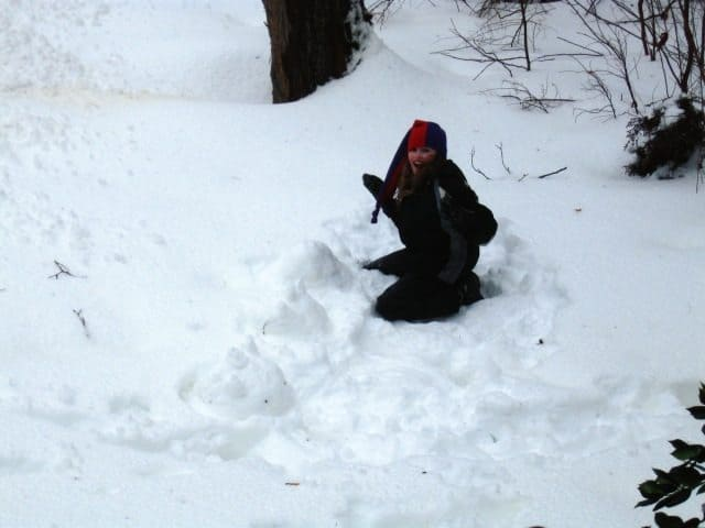 Leanne O'Donnell made a snow serpent Thursday. Photo Credit: Amy Goldstein.