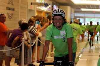 Martha Moseley of Yardley, Pa. bikes into the Quaker Bridge Mall Saturday.
