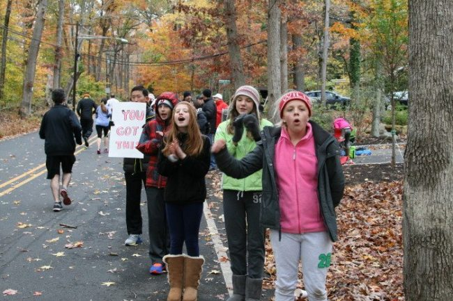The Herrontown Road cheering section was not deterred by the cold weather. Photo courtesy of Stella Rho.