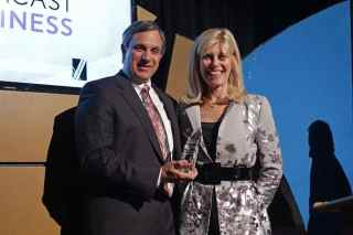 Photo Caption: Michael Aversa, Partner, EisnerAmper LLP, presents Debbie Schaeffer with her Hall of Fame award at the NJBIZ Business of the Year Awards.