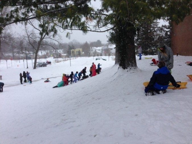 Families enjoy the snow at Westminster Choir College in Princeton on Tuesday, Jan. 27. Photo: Amy Zakar.