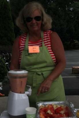 Support crew member Ann Brown makes fruit smoothies for the cyclists on Friday.