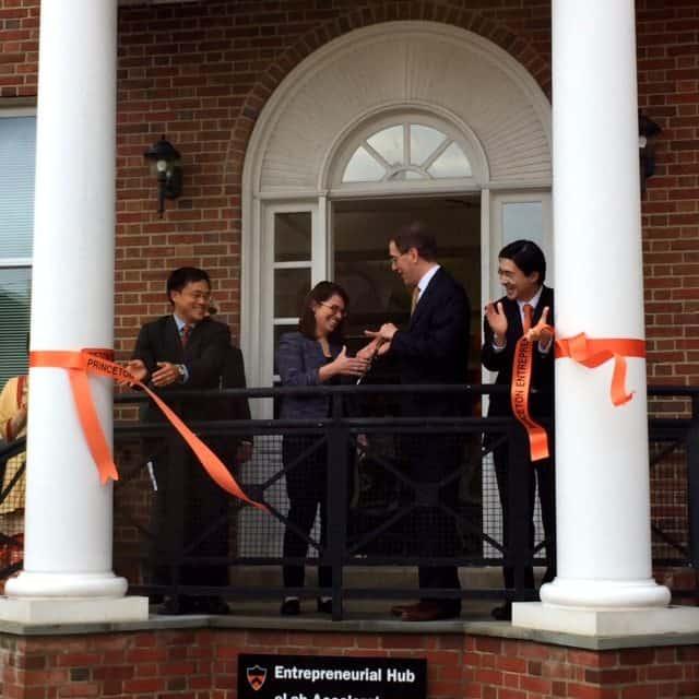 Princeton University President Chris Eisgruber and Mayor Liz Lempert cut the ribbon at the new Entrepreneurial Hub.