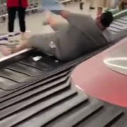 All Bad: Big Man Gets Pushed Onto A Baggage Carousel & Has Trouble Getting Off!