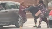 Road Rage: 2 Chicks Jump A Woman In The Middle Of The Street!