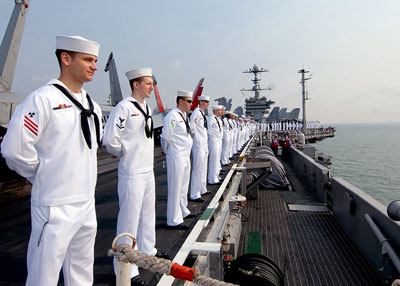 Sailors man the rails aboard the aircraft carrier USS George Washington (CVN 73) while underway off the coast of Singapore. Photo by Mass Communication Specialist Seaman Adam K. Thomas