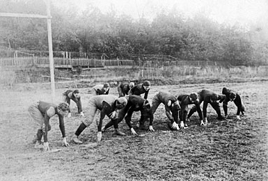 This is what football looked like in 1913. The team is the Scarlet Knights, who defeated Princeton in the first football game ever planed, back in 1869.