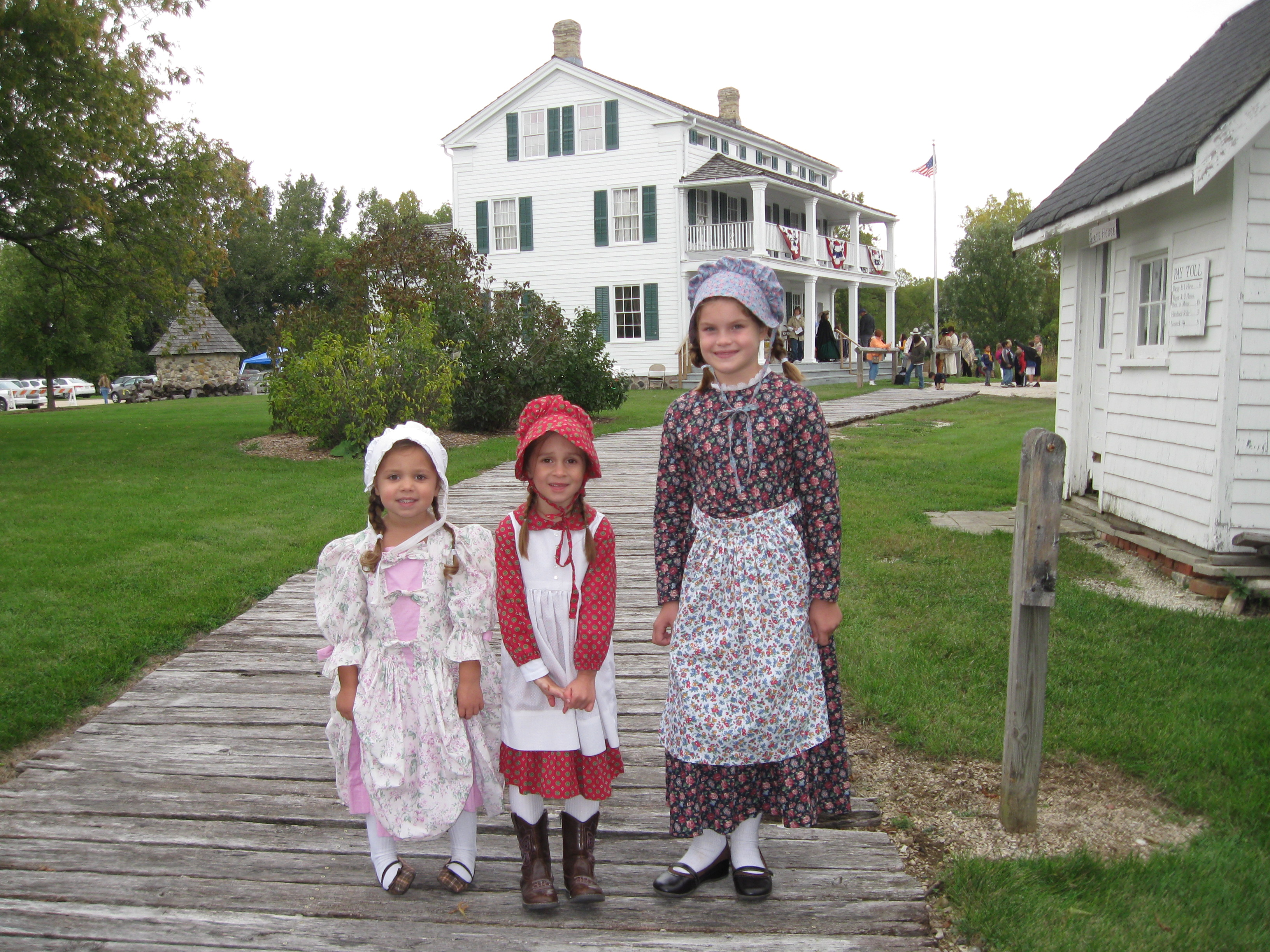 """Emma, an """"unknown Laura"""" and Olivia on the plank road at the Dousman Stagecoach Inn"""