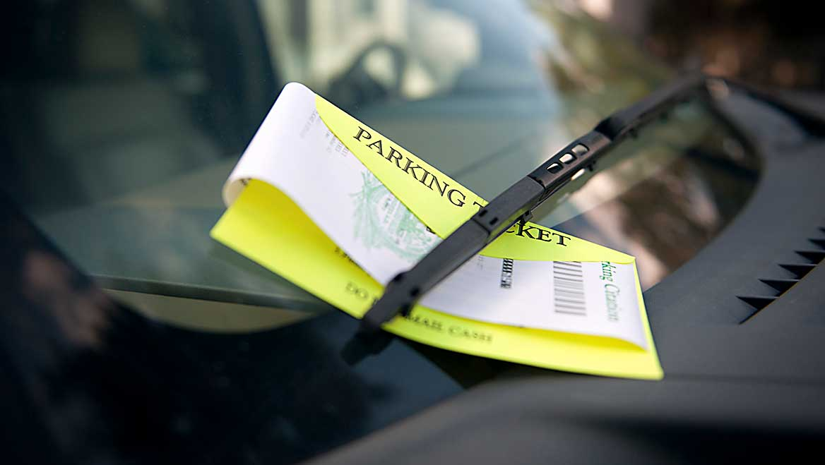 The best run parking enforcement programs encourage compliance with fees that are high enough to discourage overtime parking, and even higher for violations that impede travel, like parking in bike lanes. Photo by Westhoff/E+/Getty Images.