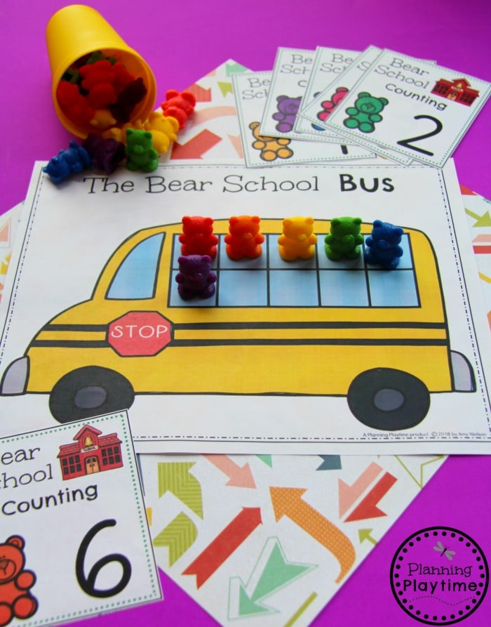 Yellow bus printable with 10 frame windows. Counting cards and rainbow colored bears to make the number.
