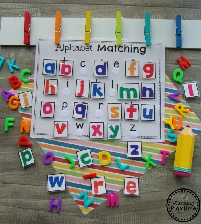 page with alphabet letters and velcro dots with colored alphabet squares to match and attach
