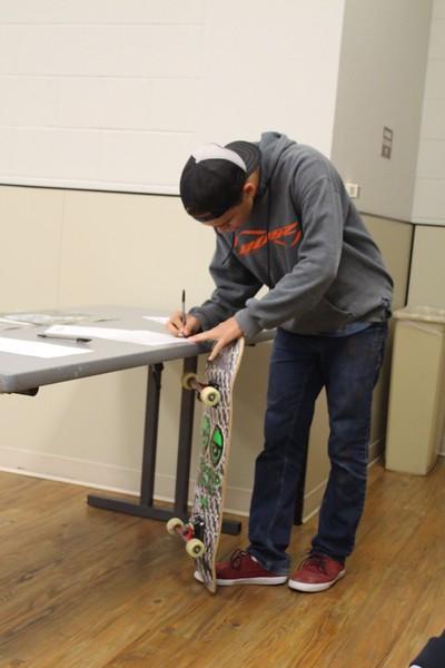 kid skateboard meeting skatepark