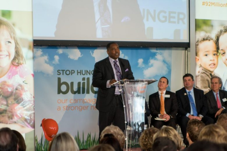 Mayor Harry Larosiliere addresses the crowd at the ground breaking event for the new NTFB distribution facility