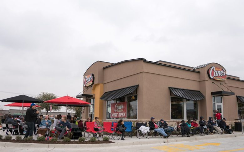 Dreary weather didn't deter any of these people from waiting for their free chicken.