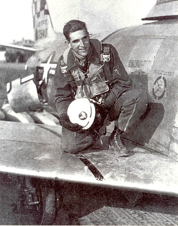 "Congressman Sam Johnson in Korea, 1953, on the wing of an F-86 named ""Shirley's Texas Tornado"""