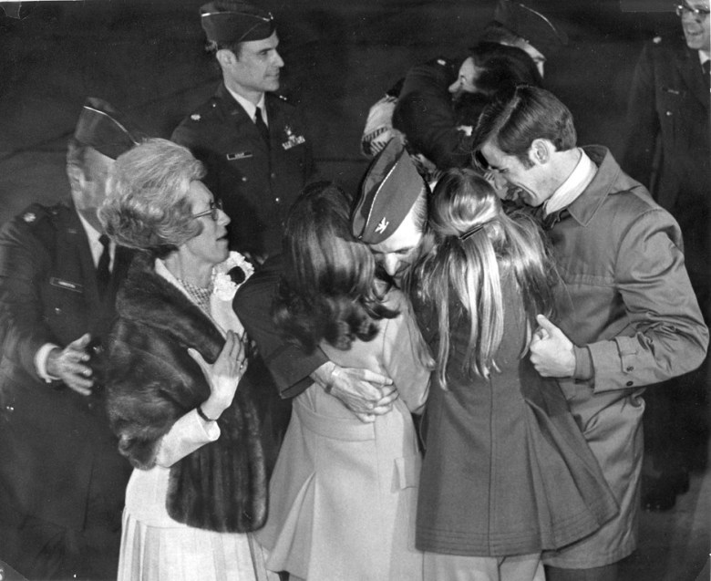 Congressman Sam Johnson greeting his family on the tarmac at Sheppard Air Force Base. (The first time seeing his family after nearly seven years in the infamous Hanoi Hilton.)