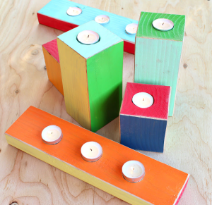<img source='pic.gif'='Multi coloured candle holders'/>