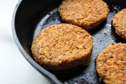 Cannellini bean veggie burger in cast-iron skillet