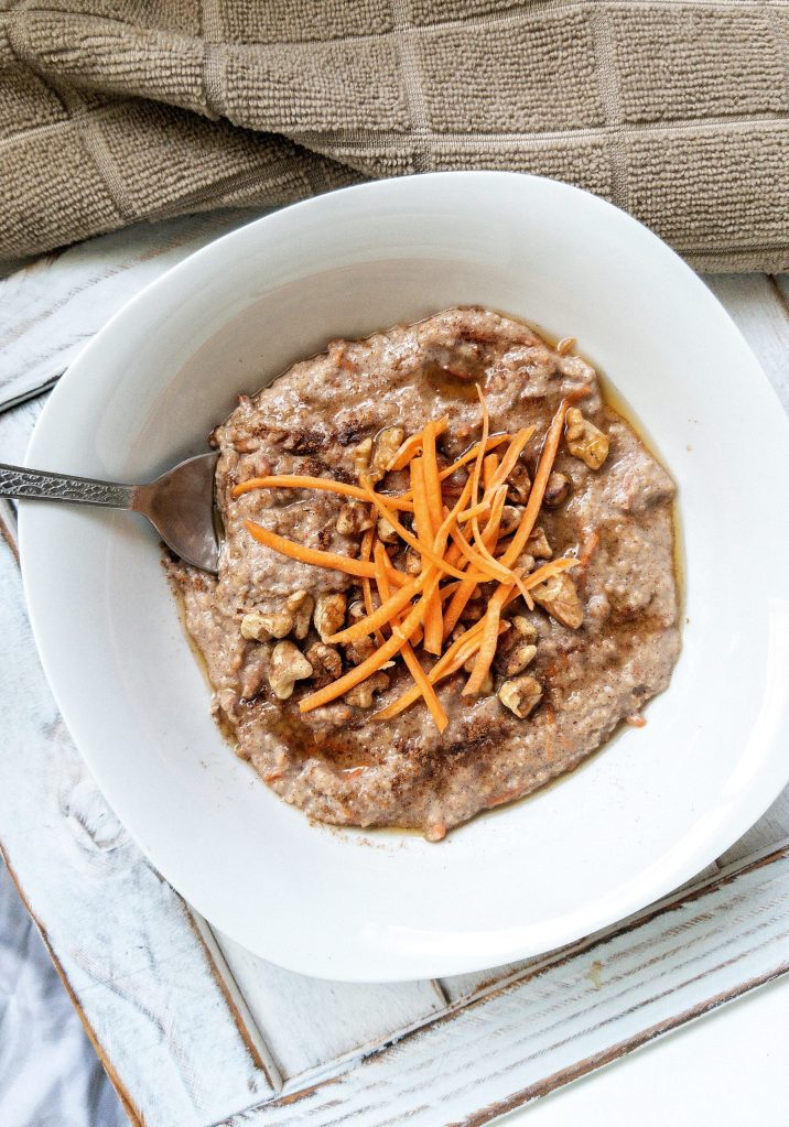 Oat bran cooked with coconut oil, shredded carrots, cinnamon, brown sugar, and topped with toasted walnuts and a drizzle of honey.