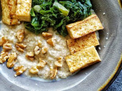 Oat bran with tofu, greens, and walnuts
