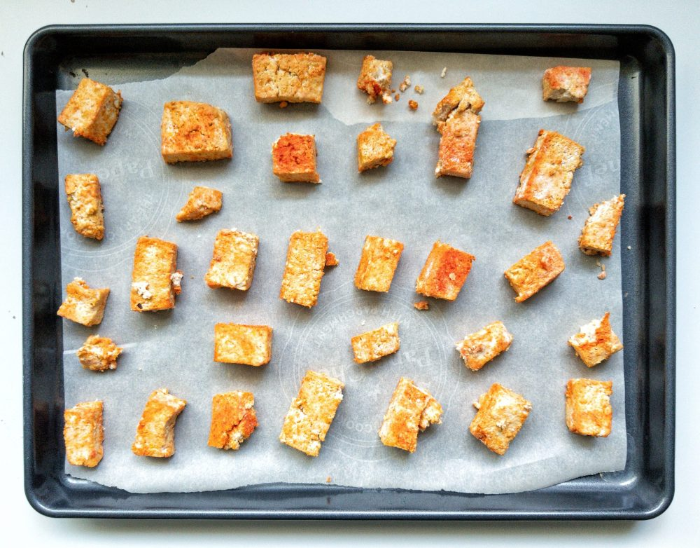 Cubbed firm tofu coated with seasonings and flour