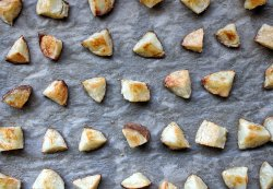 Chopped russet potatoes baked on parchment paper
