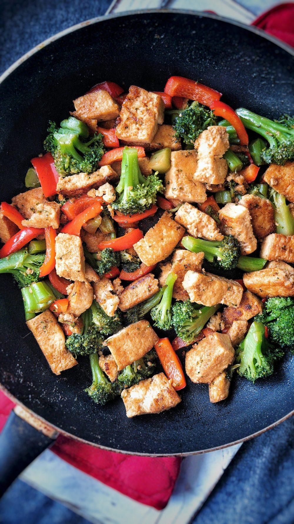 "Vegan teriyaki ""chicken"" stir-fry made with tofu, broccoli, and peppers."