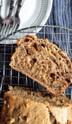 Oven-baked healthy banana nut bread with walnuts. With one slice cut from the loaf.