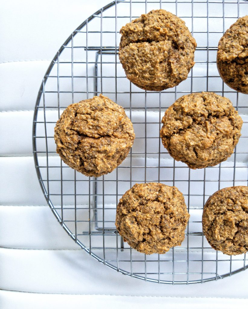 Fluffy chia seed pumpkin muffins on a round cooling rack