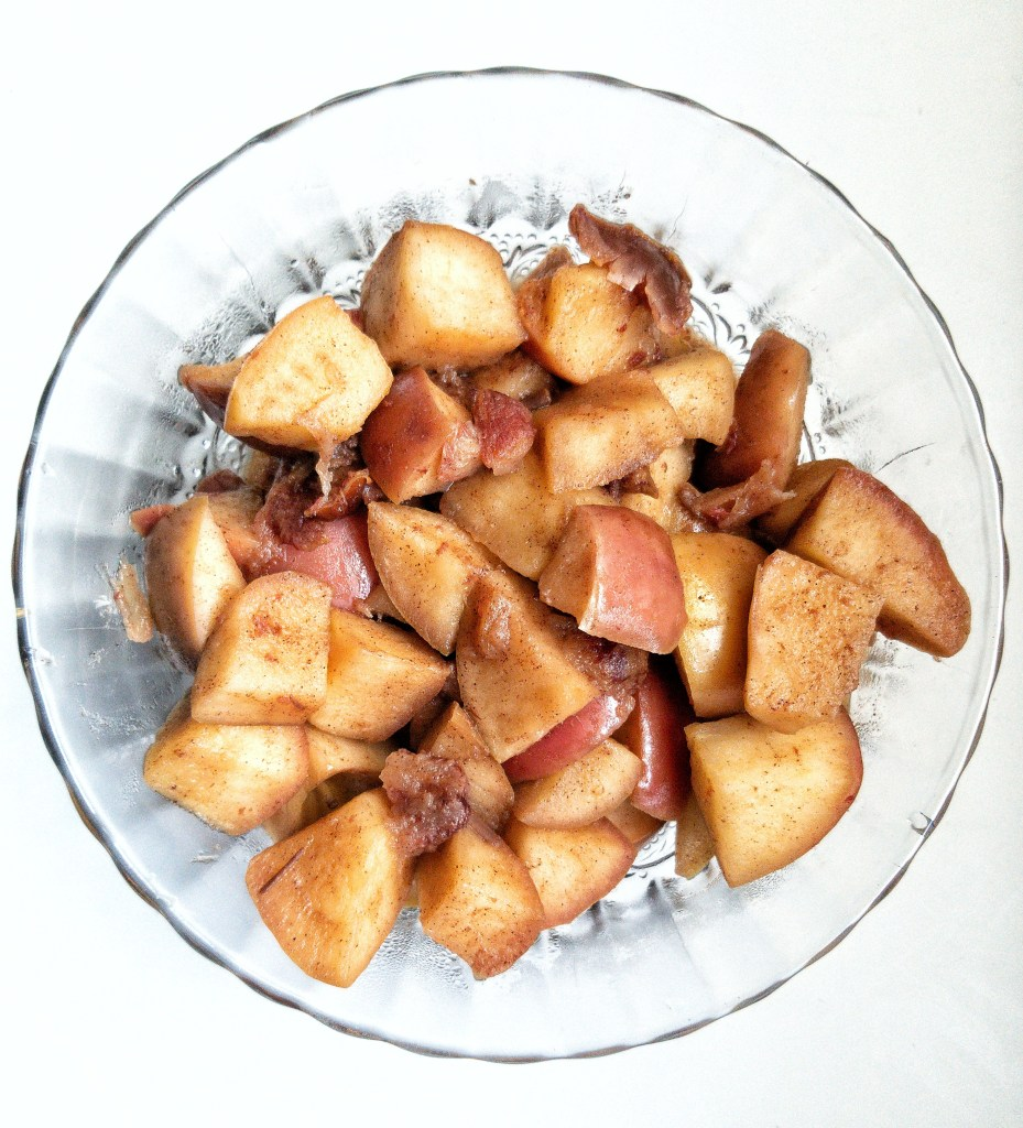 Simmered apples with dates and cinnamon in a bowl