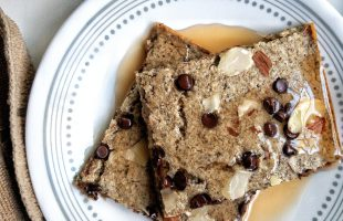 Pancake squares from gluten-free oven sheet pancakes topped with sliced almonds and vegan chocolate chips