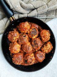 Homemade vegan tofu meatballs in a skillet