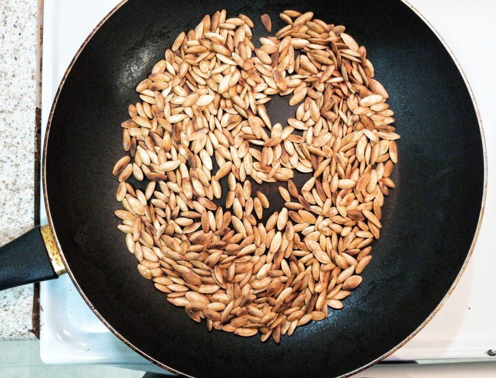 Pumpkin seeds in a skillet