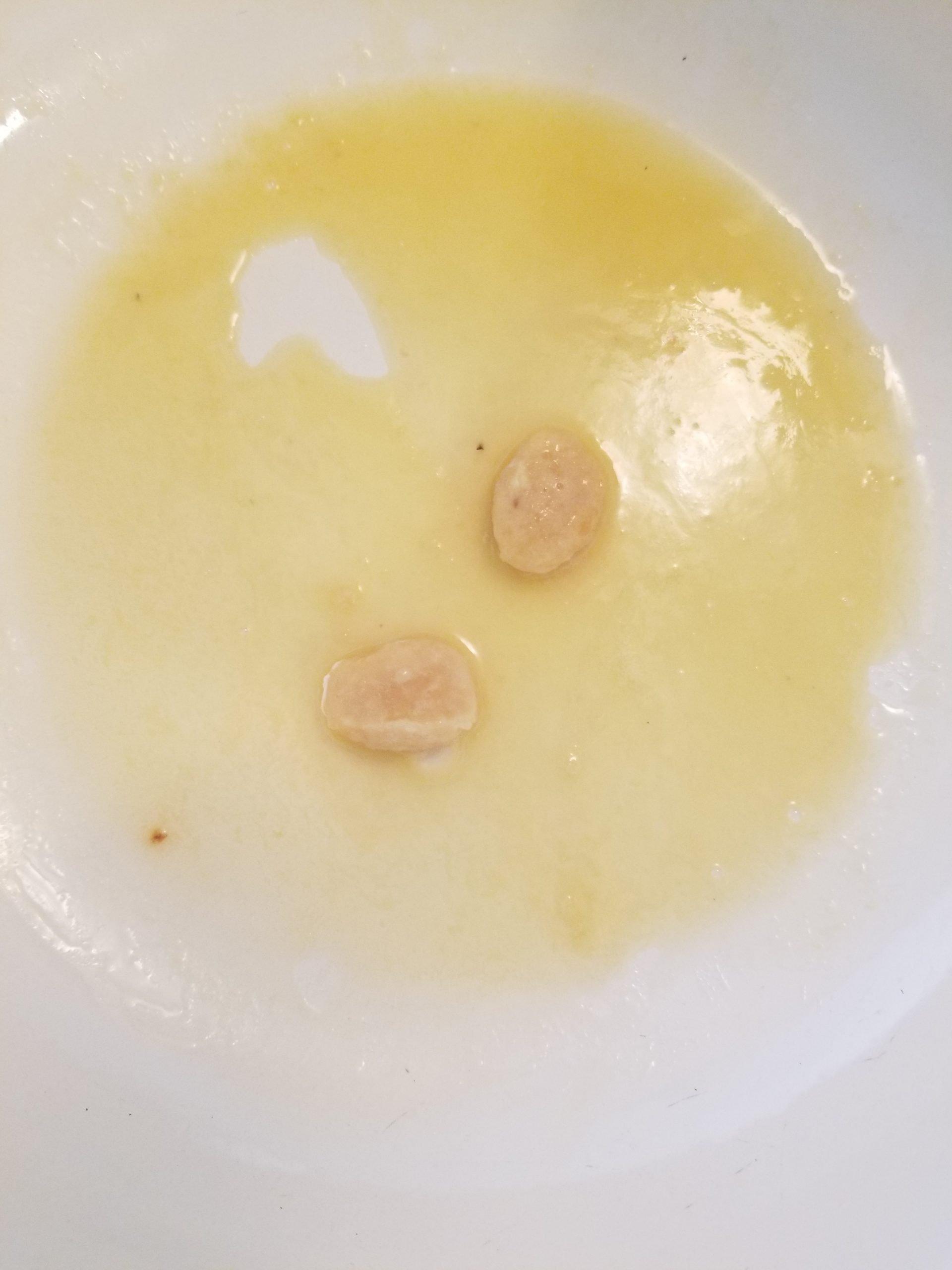 Frozen crushed garlic in melted vegan butter