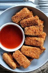 Extra crispy and crunchy tofu nuggets with a homemade honey hot sauce