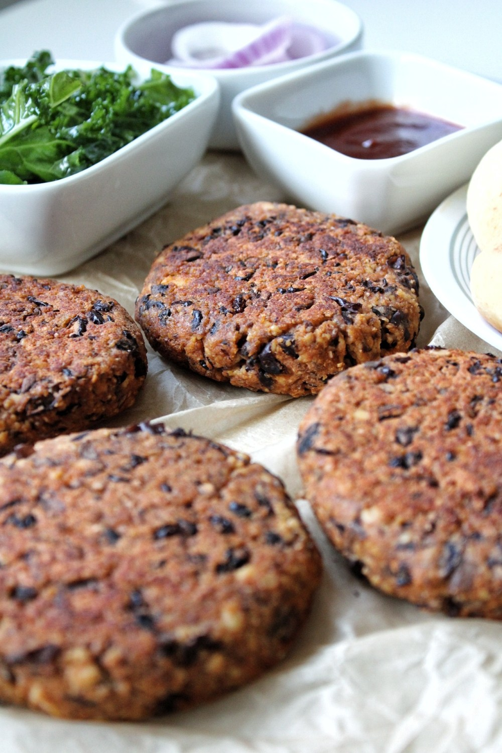 Cooked veggie burger with sides and sauces