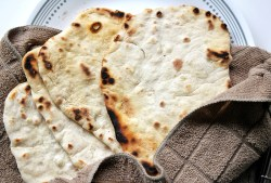 Vegan, no-yeast flatbread wrapped in a towel