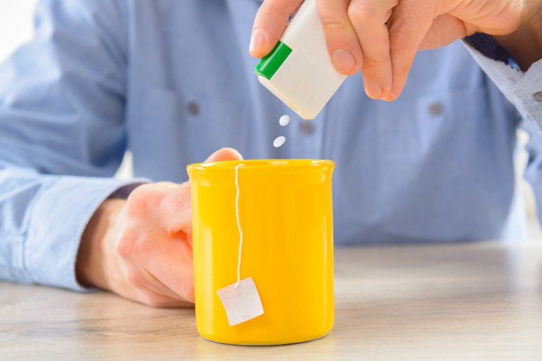 Aspartame, a common sweetener, being used in a cup of tea